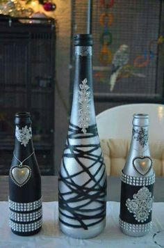 Image result for silver wine bottle centerpieces