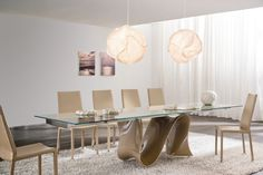Wave is a fixed or extendable table with aluminum guide bar, top and extensions in tempered glass. Moulded base in Baydur, a new generation material which combines liberty, creativity and functionality. Wave furnishes your home in the light of extreme design.