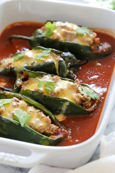 These baked Turkey Enchilada Stuffed Poblanos Rellenos are stuffed with a flavorful ground turkey filling, topped with my homemade enchilada sauce and cheese. These are so much lighter than restaurant (Favorite Recipes Enchilada Sauce) Low Carb Recipes, New Recipes, Dinner Recipes, Cooking Recipes, Favorite Recipes, Healthy Recipes, Cake Recipes, Advocare Recipes, Candida Recipes