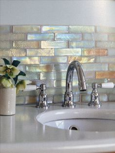 Metallic tiles add a touch of personality to your bathroom. We can see these becoming more and more popular as time goes on.