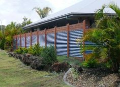 Corrugated metal fence with wood trim