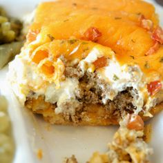 Saddle up and make this John Wayne casserole - ground beef, tomatoes, biscuit mix, sour cream John Wayne Casserole, Pasta, Cookies Et Biscuits, Casserole Dishes, Beef Casserole Recipes, Breakfast Casserole, Ravioli Casserole, Casserole Ideas, Cornbread Casserole