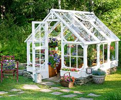 This greenhouse is made from the windows of an old dairy farm. Virtually all the materials are recycled, save for the galvanized screws that hold it all together. It provides the perfect greenhouse for budding annuals. Backyard Greenhouse, Small Greenhouse, Greenhouse Plans, Old Window Greenhouse, Greenhouse Film, Greenhouse Wedding, Greenhouse Attached To House, Underground Greenhouse, Portable Greenhouse