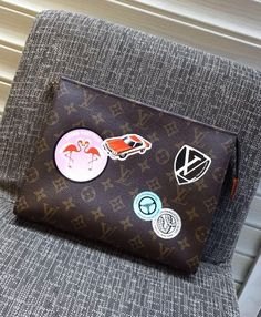 Louis Vuitton Monogram Canvas Toiletry Pouch 26 with Classic Hotel Stickers.  Check more LV monogram handbags at http://luxtime.su/louis-vuitton-handbags/monogram-canvas