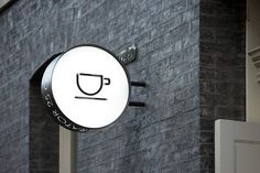 The other side of the signage with custom coffee pot icon.