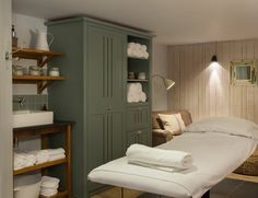 Fantastic storage armoir. Love the color too.  #treatment #massage #room