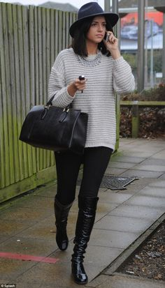 Lucy looks miserable as she leaves her shop in Brentwood