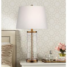 Collect your choice of decorative objects to place in the base of this clear glass table lamp.