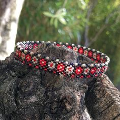 Bracelet woven with small flowers beige, red and bronze miyuki beads and then varnished with a soft varnish which gives a structured and flexible bracelet This bracelet is part of a trio bracelets worn together or separately according to mood... Red and sand miyuki and fire polished