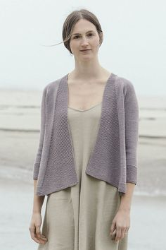 Open cardigans like Andromeda are a breeze—to knit and wear. Swingy, button-less fronts, back dart shaping, and simple garter and stockinette stitches in lightweight Tern provide all the pleasing details in this pretty design by Pam Allen. Knit Cardigan Pattern, Sweater Knitting Patterns, Knitting Designs, Knitting Yarn, Knit Patterns, Knitting Sweaters, Knitting Projects, Knitting For Charity, Knit Jacket