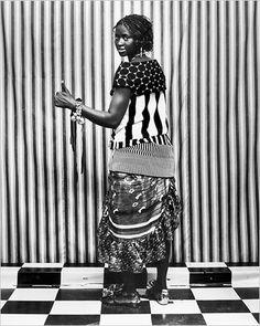 Assitan Sidibé wears a Marni polka-dot top. Christian Lacroix striped top. Marc Jacobs dress. Christian Louboutin shoes. Dries Van Noten bracelet.    Photo: Malick Sidibé for The New York Times