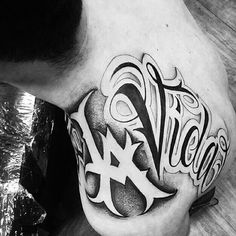 The Tattoo Chicano Design by Big Sleeps is a big scale lettering tattoo design placed on the top of the shoulder and falling down the back. Skull Sleeve Tattoos, Tattoo Sleeve Designs, Body Tattoos, Life Tattoos, Tattoo Designs Men, Chicano Style Tattoo, Chicano Tattoos, Chicano Lettering, Tattoo Lettering Fonts