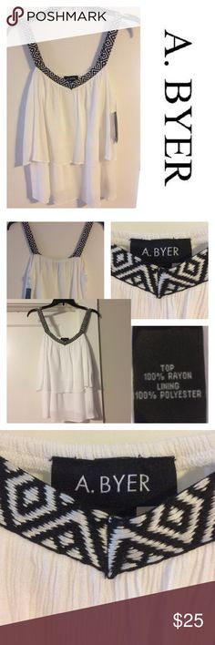 Layered top with embroidered straps Elegant, classy and in style. You just can't go wrong with this. Had two layers and lined. a byer Tops Camisoles