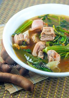 Pork Sinigang is a delicious Filipino sour soup dish. The soup is made from any cut of pork along tomato, string beans, spinach, and tamarind Pork Sinigang, Sinigang Recipe, Filipino Recipes, Asian Recipes, Filipino Food, Ethnic Recipes, Pork Recipes, Cooking Recipes, Healthy Recipes