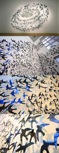 Artist Julia Barello's swirling wall installation titled Swoop features a swarm of birds cut out of MRI film.