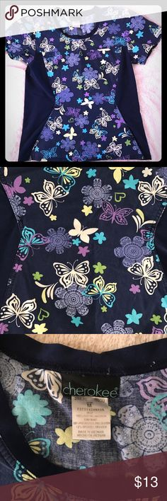Cherokee butterfly scrub top M stretch In good condition, some fading. Gorgeous butterfly 🦋 print on a navy background. Sides are Spandex and stretch. Very comfy and flattering! ❤20% of this purchase goes to ahead and Neck cancer research❤ Cherokee Tops