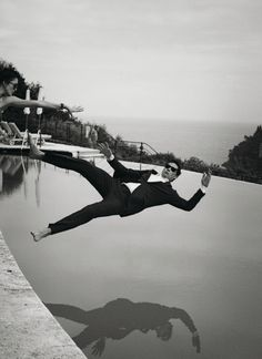 Alain Delon is perfect even when he's falling into a pool