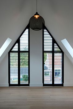 Dark wooden shutters as an accent in a light room. Rural modern villa Dark wooden shutters as an acc