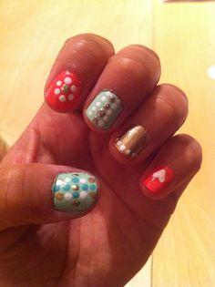 Mint, coral, gold manicure