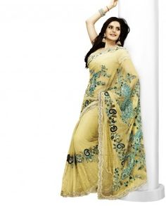 $168Its a beautiful yellow party wear sari for a gorgeous women. Color of the sari is yellow and fabric used is georgette. Green and turquoise embroidery is done on pallu which further adds to its looks.    Saree will come with an  unstitched blouse  Color-Yellow  Material-Georgette  Work-Machine embroidery  Slight variation in color is possible