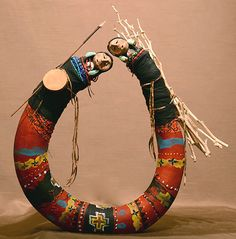 My Note: Looks like Twin Dreamer who comes with baskets and gives the rights to do quill work and brings the songs. In memory of Nellie Two Bulls.   Double Maidens Gourd figure by Robert Rivera