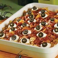 "The ""eyeballs"" that top our spooky casserole are made from mozzarella cheese and sliced olives. But the cheesy, baked pasta that lies below is a real Halloween treat that everyone will enjoy."