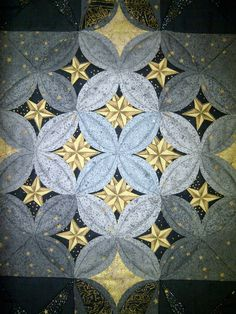 close up photo, Cathedral Window quilt workshop with Lynne Edwards at Mahone Bay Quilters' Guild (Nova Scotia). Stars were placed inside the windows.
