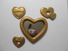 Vintage gold heart shaped mirror with three little by Primetimer