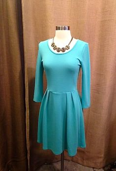 This simple turquoise dress from Pieces Boutique  is sweet and feminine. What to Wear to Events This Spring. Featuring Affordable Items! www.styleblueprint.com