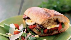 Pan bagnat is a French sandwich made by filling a loaf of country bread with layers of veggies, olives and eggs. The sandwich is then allowed to sit several hours so the bread absorbs all of the juices.