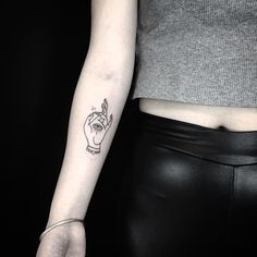 « Little hand and eye for Chloe. » tattoo by Russell Winter @russellxwinter @hiddenmoontattoo