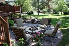 creating a backyard retreat with a new patio water feature and an expanded deck, decks, gardening, landscape, outdoor furniture, patio, ponds water features, The addition of the patio brings a new space to relax at the end of the day By adding a fire table rather than a permanent fire pit the client can enjoy a warm fire with the ability to change the layout to fit their needs