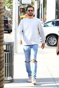 Scott Disick wearing Common Projects Pink Original Achilles Sneakers, Ksubi Van Winkle Non Cents Distressed Skinny Jeans, Saint Laurent Aviator-Style Gold-Tone Sunglasses