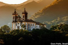 Ouro Preto (translation: Black Gold) is a former mining area nestled in Brazil's Serra do Espinhaço mountains. A UNESCO world heritage site in the state of Minas Gerais, the city is notable for both its Brazilian Gold Rush past, and also for once having the largest population in the New World of 1750: 80,000 people. This photo features the beautiful Church of Nossa Senhora do Carmo, a Catholic church built in the Rococo tradition.
