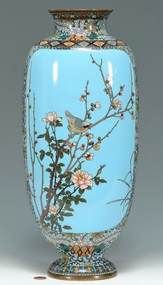 "Tall Japanese Meiji period cloisonne vase, ovoid footed form with blue ground and aesthetic style decoration to rim, foot and sides. Panels depict a bird on flowering prunus branches on one side and on the other, a landscape with house and gate. 16""H."