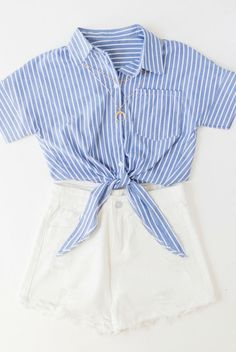 white and blue pin stripe, button up shirt, blouse, front tie, vertical, preppy, white high waist, jean shorts, distressed denim // The Copper Closet, fashion, boutique, clothing, affordable, style, woman's fashion, women fashion, online shopping, shopping, clothes, girly, boho, comfortable, cheap, trendy, outfit, outfit inspo, outfit inspiration, ideas, Jacksonville, Gainesville, Tallahassee Florida, photo shoot, look book