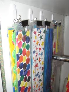 Bulletin Board Border storage: Binder clips and Command Strips