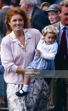Sarah, Duchess of York, with Princess Beatrice after disembarking the Royal Yacht Britannia, at Scrabster Harbour, to visit The Queen Mother, at The Castle of Mey, on August 12, 1990 in Thurso, Scotland.