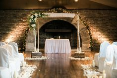 Simple classic chuppah indoor with brick wall found on Modern Jewish Wedding Blog // Photo by Juicebeats Photography  http://juicebeatsphotography.com