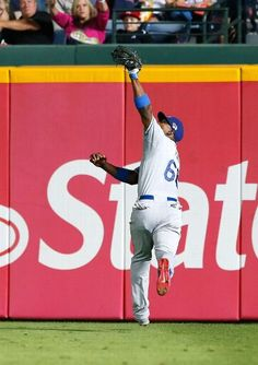 Yasiel Puig #66 of the Los Angeles Dodgers catches a fly ball hit by Mike Minor #36 of the Atlanta Braves in the 5th inning during Game 2 of the National League Division Series at Turner Field on October 4, 2013 in Atlanta, Georgia. (Photo by Kevin C. Cox/Getty Images)