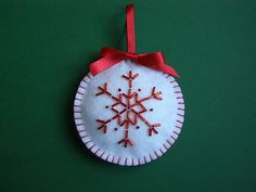 Hand-made Christmas decoration. Felt bauble with beaded snow flake.