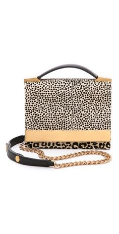 Gorgeous leopard clutch - love that it has two different prints - one large, one small to make it edgy
