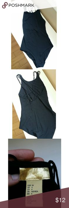 H&M Black Bodysuit Size 4 H&M Black Bodysuit size 4. Please see photos for full description on style. Design on back. H&M Tops