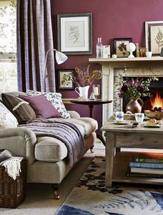 Hibernate with feel-good colour and snug comforts. Combine the winter palette of claret and plum with earthy wood textures for a living room that you won't want to leave. Colour block the main wall with a rich port tone and use softer mauve-greys, browns and greys for accessories. Finally, adorn walls with numerous prints depicting foliage, ferns and flowers for a fresh feel