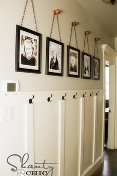 knobs to hang pictures hung by chain or ribbon.  hallway idea