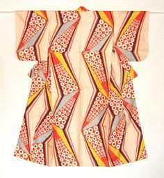 Meisen kimono with geometric pattern which is warp and weft kasuri. Mid 20th century. via Haruko Watanabe