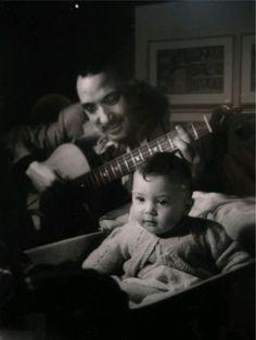 Django unplugged! Jazz legend Django Reinhardt plays for his son, Babik, in 1944.
