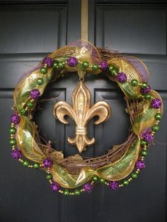 I need to figure out how to take a pic of the mardi gras wreath I made and put on here. Love decorating for all holidays.