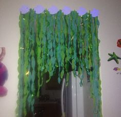 Seaweed decor for under the sea party made by twisting  streamer and iridescent tissue paper!