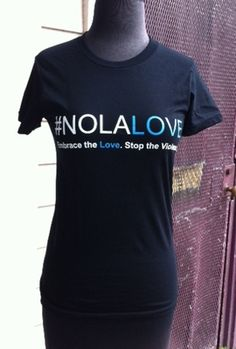 "Designed by the student team from Edna Karr Secondary School for the Idea Village/Brees Dream Foundation ""Trust Your Crazy Ideas Challenge"". We donate $5 from the sale of every #NOLALOVE shirt to afterschool programs in New Orleans to keep kids off the streets. Edna Karr was awarded $10,000 from the Brees Dream Foundation for winning the 2011 Idea Bowl and Google also awarded scholarships to the winning team of Karr students that participated in this design."